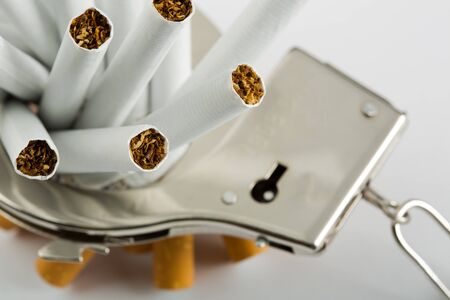 Heap of cigarettes locked to handcuffs. Closeup view Stock Photo - 18104444