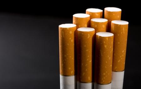 cigarette filter: Heap of cigarettes. Closeup view