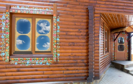 Wooden chalet with big window photo
