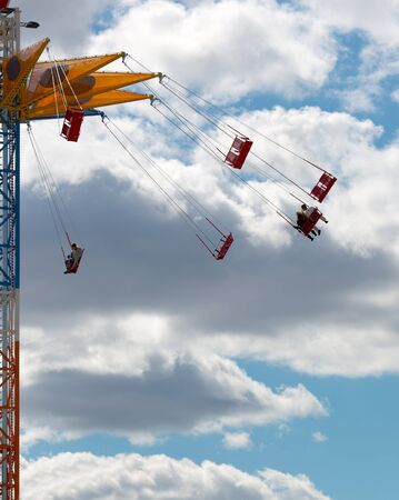People riding on chairoplane in sky