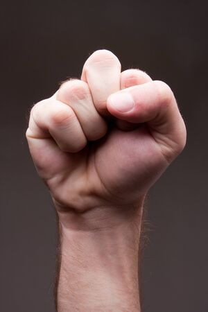 arm muscles: Close-up of man fist - symbol of power Stock Photo