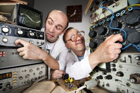 Two funny nerd scientists working at vintage technological laboratory Stock Photo - 18104013
