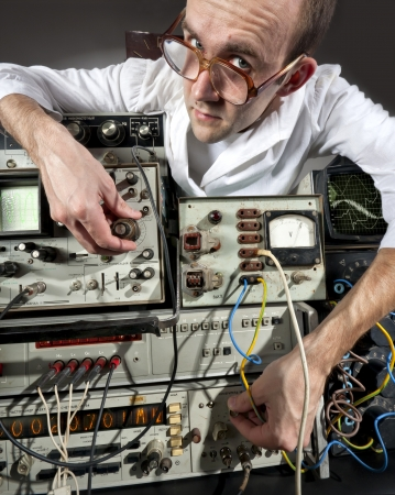 Pensive scientist working at vintage technological laboratory Stock Photo - 18103938
