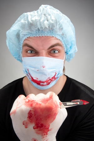 mischief: Mad mental sick blood soiled surgeon with knife