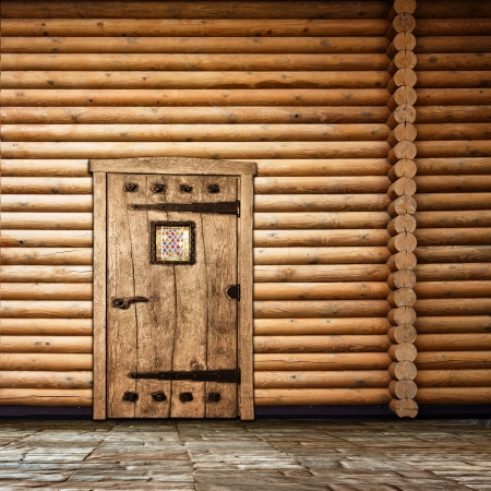log cabin: Wooden wall with old door Stock Photo