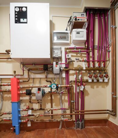 Complex heating system with boiler, tubes and valves photo