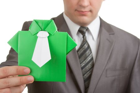 Businessman showing green origami suit in hand Stock Photo - 18103869