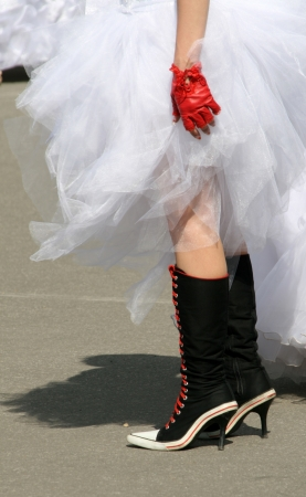 Emo bride in boots and gloves photo