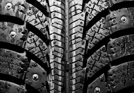 Close-up of new winter tire background or texture photo