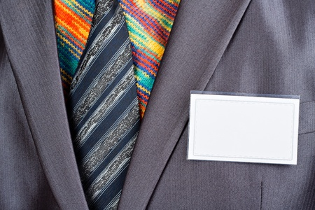 Businessman in formal grey suit and colorful shirt Stock Photo - 18104657