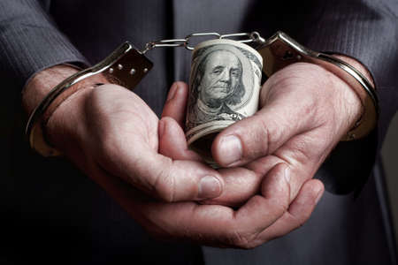 Business man in handcuffs arrested for bribe Stock Photo - 18103940