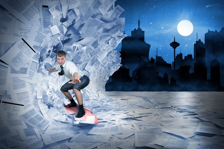 Confident surfer riding the barrel of documents wave Stock Photo - 18103948
