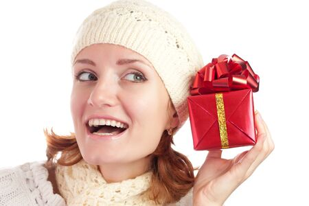 Beautiful smiling woman with gift. Isolated on white Stock Photo - 18103384