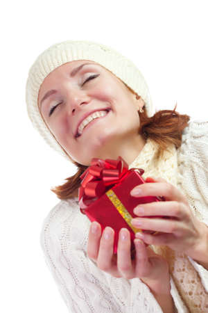 Happy smiling woman with gift. Isolated on white Stock Photo - 18103388