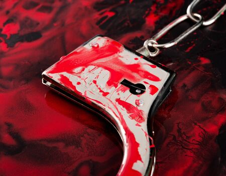 Close-up of handcuffs in blood Stock Photo - 18104618