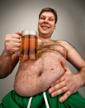 naked belly: Portrait of funny fat man with glass of beer Stock Photo