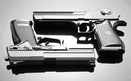 Two handguns. Desert Eagle and M23 Double Eagle Stock Photo - 18103327
