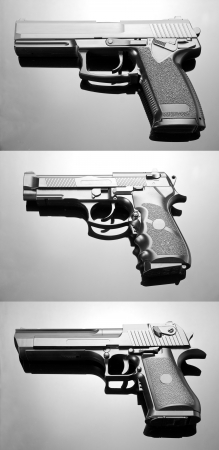 Three handguns. Beretta 92, Desert Eagle and M23 Double Eagle Stock Photo - 18104652