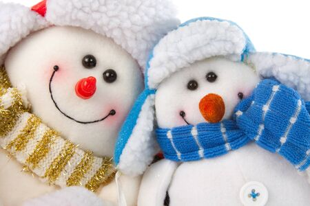 Happy smiling snowman couple. Isolated on white photo