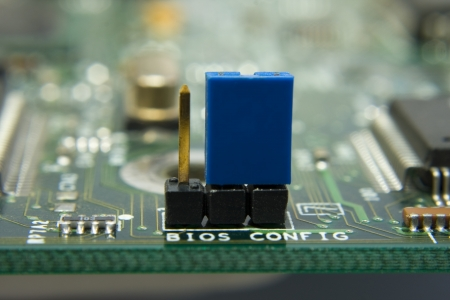 config: Computer motherboard circuit. Jumper BIOS config in the center Stock Photo