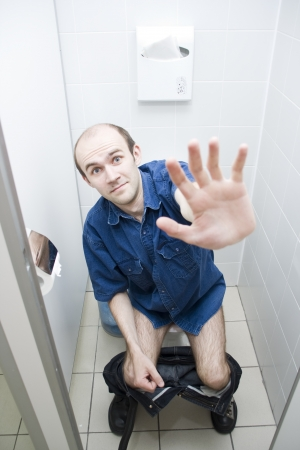 urinating: Scared man in toilet