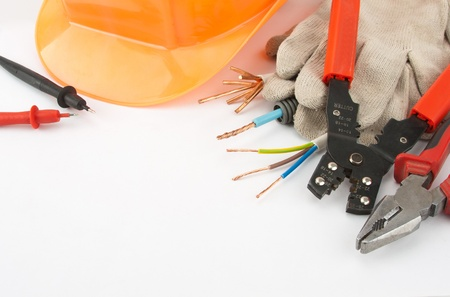 electrical engineer: Electricians tools. Hardhat, pliers, cables, cutter, etc.