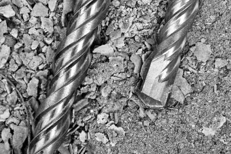 Industrial drills on cracked concrete. Close-up view photo