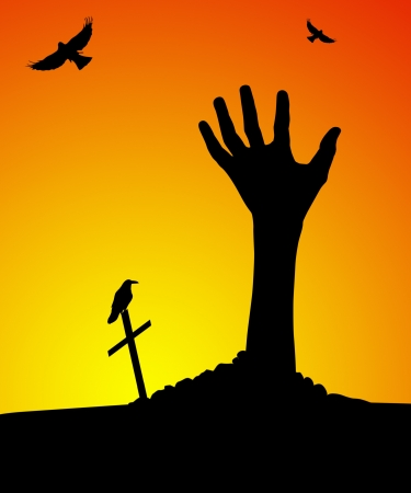 Zombie hand rising out of grave at sunset photo