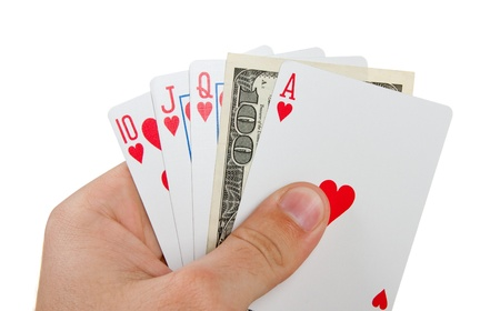 Royal flush with $100 in hand. Isolated on white photo