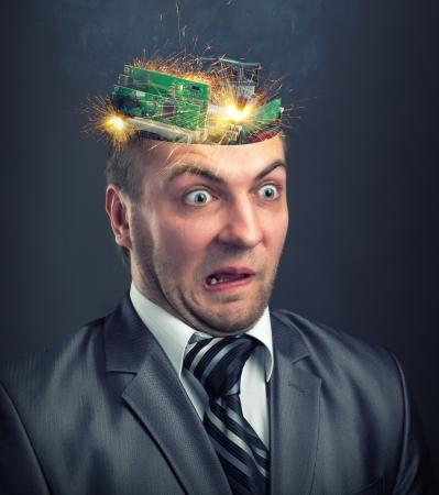 failure sign: Short circuit in businessman computer brain