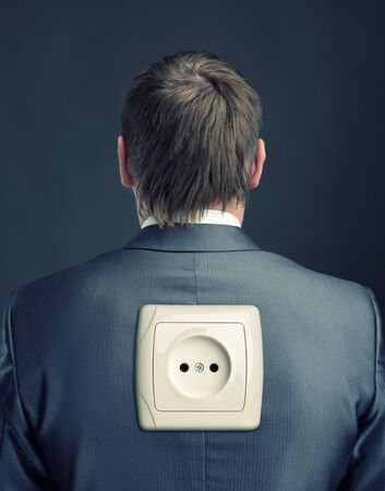 Businessman with electrical outlet on back photo