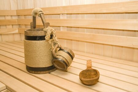 finland sauna: Sauna. Bucket, cup and ladle on the seat