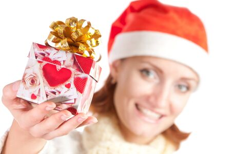 Happy smiling woman in christmas hat with gift. Isolated on white Stock Photo - 18190510