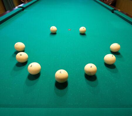 billiards hall: Smile shape billiard balls on green table