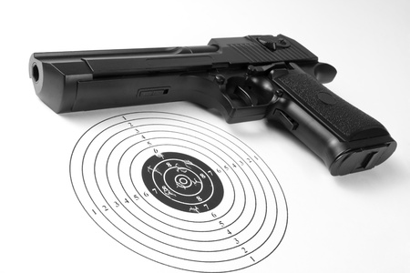 practicing: Target with holes and gun