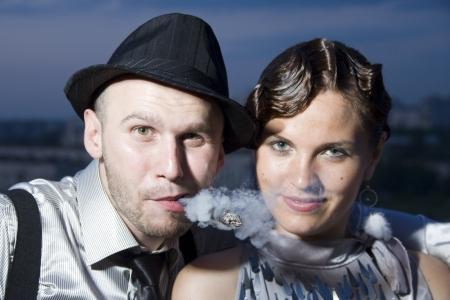 smoking cigar: Young retro couple