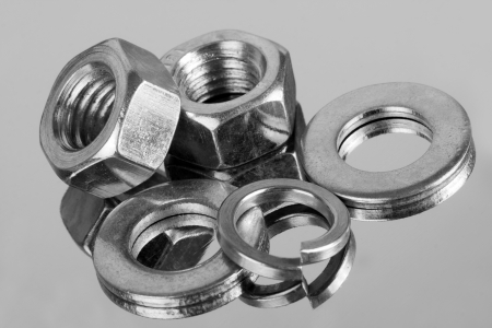 fasteners: Small industrial equipment - nuts and washers. Close-up