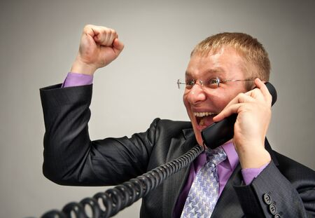 Portrait of happy businessman talking by phone Stock Photo - 18192553