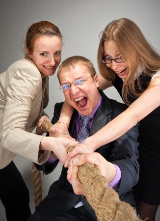 Portrait of business team pulling a rope photo