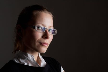 Portrait of beautiful pensive businesswoman in glasses photo