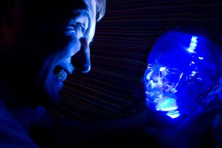 smother: Man choking the alien Stock Photo