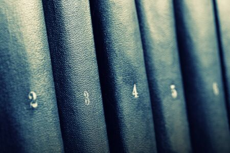 numbered: Row of books. Toned in blue