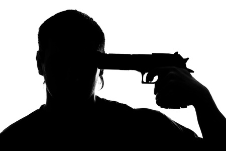 Silhouette of man shooting himself. Isolated on white photo