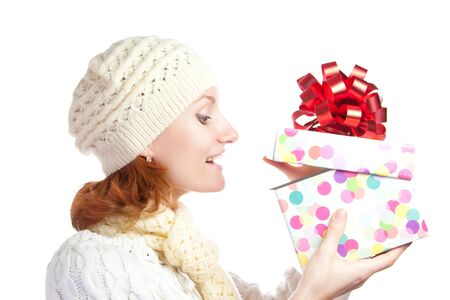 Happy smiling woman opening christmas gift. Isolated on white Stock Photo - 18304397