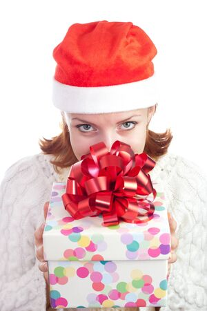 Happy smiling woman in christmas hat with gift. Isolated on white Stock Photo - 18304445