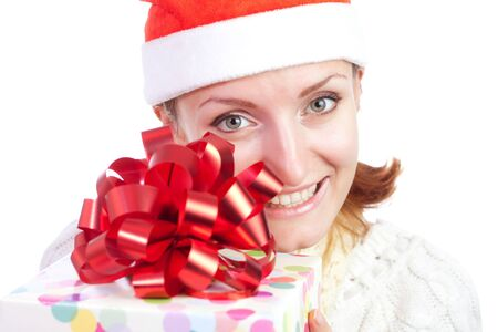 Happy smiling woman in christmas hat with gift. Isolated on white Stock Photo - 18304411