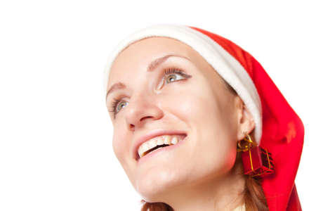 Portrait of happy smiling woman in christmas hat with gift earring. Isolated on white Stock Photo - 18304477