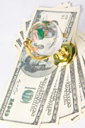 Glass globe and dollars photo