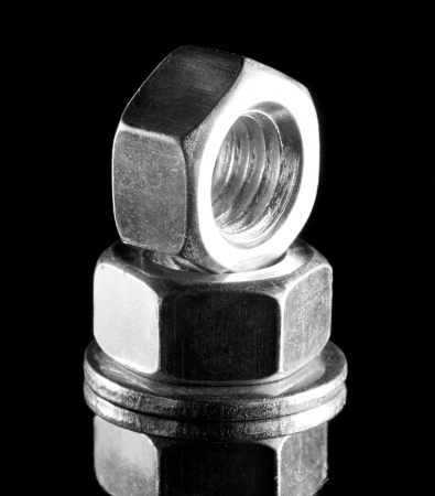 Close-up of two steel nuts. In B/W Stock Photo - 18288467