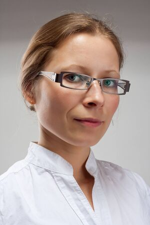 Portrait of happy smiling business woman in glasses photo